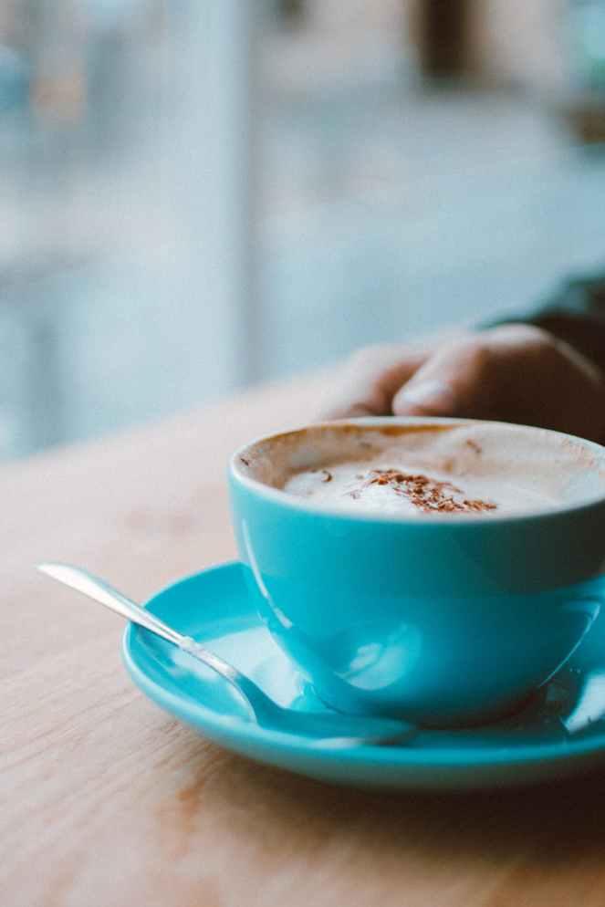 shallow focus photo of teal ceramic mug