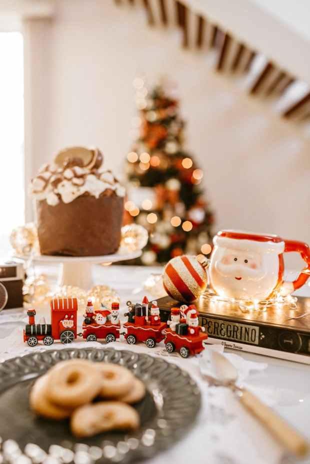 selective focus photography of christmas train and santa claus mug on table